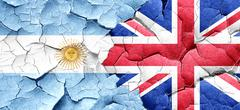 Argentina flag with Great Britain flag on a grunge cracked wall Stock Illustration