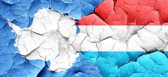 antarctica flag with Luxembourg flag on a grunge cracked wall - stock illustration
