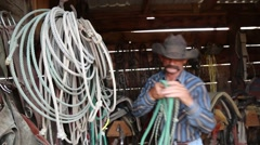 Cowboy walking over to his horses in a pen (1) Stock Footage