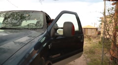 Cowboy stepping out of his truck in the desert Stock Footage