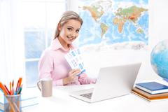 Female travel agent at office Stock Photos