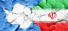 Antarctica flag with Iran flag on a grunge cracked wall Stock Illustration