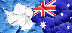 antarctica flag with Australia flag on a grunge cracked wall - stock illustration