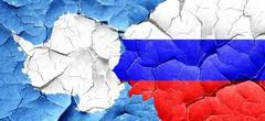 antarctica flag with Russia flag on a grunge cracked wall - stock illustration