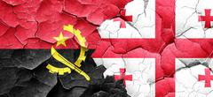Angola flag with Georgia flag on a grunge cracked wall - stock illustration