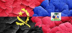 Angola flag with Haiti flag on a grunge cracked wall Stock Illustration