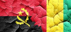 Angola flag with Guinea flag on a grunge cracked wall Stock Illustration