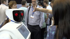 The robot communicates with the visitors in a business centre Stock Footage