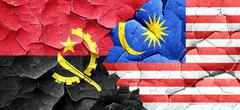 Angola flag with Malaysia flag on a grunge cracked wall - stock illustration