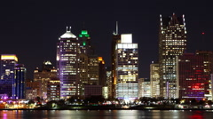 A Timelapse of the Detroit skyline at night across river Stock Footage