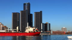 A Timelapse of the Detroit skyline with freighter crossing in front - stock footage