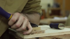 Carpenter working wood with a chisel Stock Footage