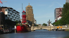 Fire-red ship in Rotterdam canal Stock Footage