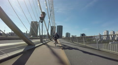 Bicycling down the Erasmus bridge (POV) Stock Footage