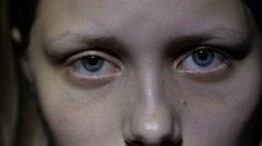 Sad teen girl, fear in her eyes. 4K UHD - stock footage