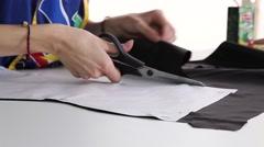 Dressmaker cutting fabric, slider shot Stock Footage