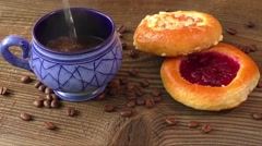 Sweet pastry with fruit jam served with hot coffee Stock Footage