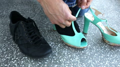 Man putting on ladies shoes Stock Footage