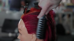 hairdressing student working on a mannequin head - stock footage