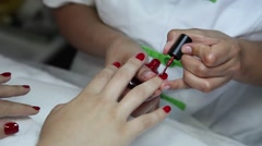 Woman doing manicure painting nails Stock Footage