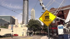 Downtown Atlanta streetview with Westin Hotel and Sundial Restaurant Stock Footage