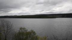 Loch Ness Scotland UK on a cloudy dull overcast day pan view famous tourist Stock Footage