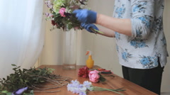 Florist creates decorations Stock Footage