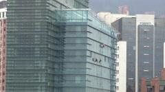 Time lapse of skyscraper window cleaners in El Poblado, Medellin (2) - stock footage