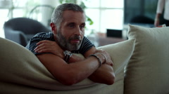 Couple leaning on cushion. - stock footage