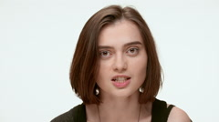 Attractive angry woman. Close up. Slow motion Stock Footage