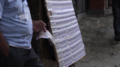 Vendor standing next to a lottery ticket stand in El Poblado, Medellin - stock footage