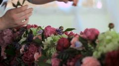 florist creates decorations - stock footage