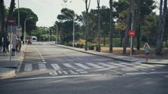 Tourist girl pedestrian cross the road by zebra crossing - stock footage