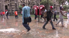 Amputee walking by telephone booth in Plaza Botero, Medellin - stock footage