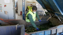 Glass waste worker in recycling facility Stock Footage