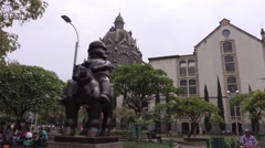 Statue Hombre a caballo with Cathedral Metropolitana in Medellin Stock Footage