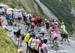 Col du Glandon, France - July 24, 2015: Group of Cyclists - Tour de France 2015 - stock photo