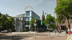 Streetcorner in Rotterdam with Picasso sculpture Stock Footage