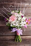 Summer bouquet from gillyflowers and alstroemeria on old wooden background - stock photo