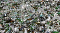 Glass waste in recycling facility. Pile of bottles. Zoom out. Stock Footage