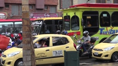 Buses stuck in traffic in Medellin, Colombia Stock Footage