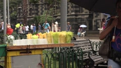 Street stand with cups of fruit in Medellin, Colombia Stock Footage
