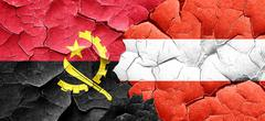Angola flag with Austria flag on a grunge cracked wall - stock illustration