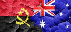 Angola flag with Australia flag on a grunge cracked wall Stock Illustration