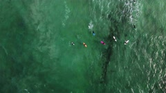 Aerial Shot of Surfers in the Arctic Ocean in Norway Stock Footage
