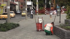 Janitor woman cleaning the street in Medellin, Colombia Stock Footage