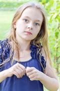 Caucasian cute girl with blond hair Stock Photos