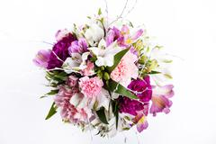 Bouquet from pink and purple gillyflowers and alstroemeria on white backgroun - stock photo