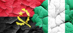 Angola flag with Nigeria flag on a grunge cracked wall - stock illustration