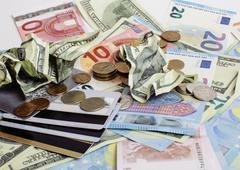 Cash on table isolated: dollars, euro, rubl broken money. All in mess, global - stock photo